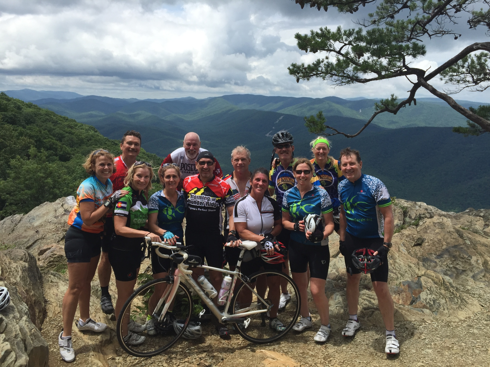 Happy cyclists at Raven's Roost overlook on the Blue Ridge Parkway near Wintergreen.
